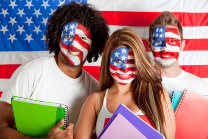 Group of American students with the USA flag painted on the face Ð isolated